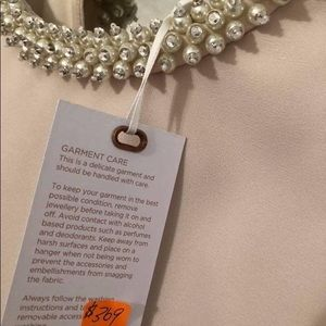 Size 4 cream dress with petal & stone neck detail